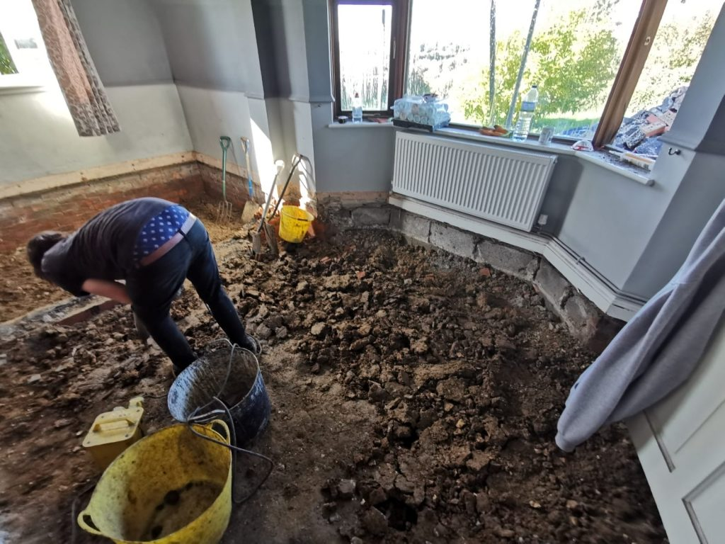 Floor being dug up by hand