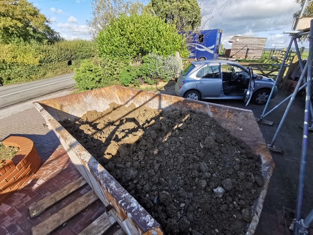 Skip full of mud, dug out from the floor