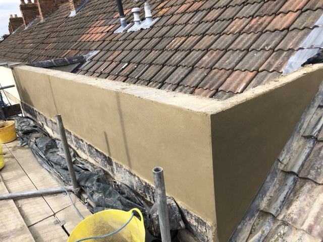 Cement render on parapet wall in Bridgwater prior to tyrolean