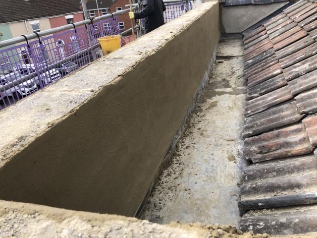Render of parapet wall in Bridgwater