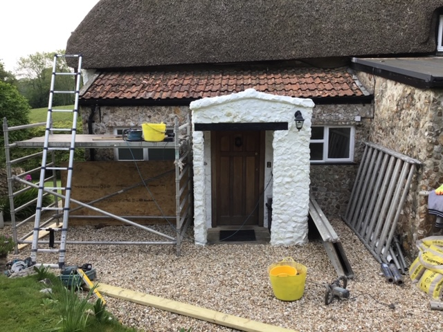 Construction of a new pitched roof on porch, including 2 new lead valleys